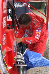 Hannagan works to ready a competitors machine before the final NRA event of 2012 at Eldora Speedway