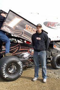 Nate Dussel poses by his no.1 305 Sprinter at Attica Raceway Park.