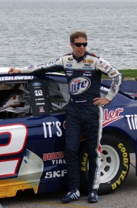 Brad Keselowski posed for a photo op by his Miller Lite Machine after his bridge journey.