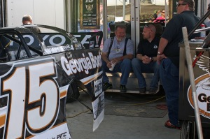 Barry Wright relaxes behind Steve Francis' no.15 machine before the evenings events.