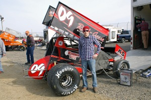 Craig Mintz proudly poses by his no.09 410 Sprinter.