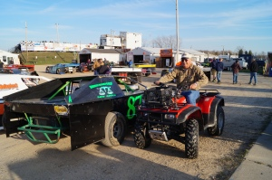 IMCA Tech Inspector Terry Williams was all smiles while tech-ing a host of Modifieds on opening night