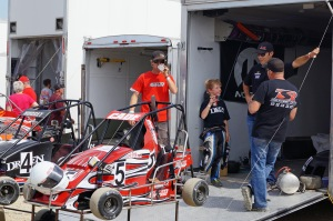 Bryan Clauson stands giving his young development driver some words of advice for piloting the no.7 .25 midget